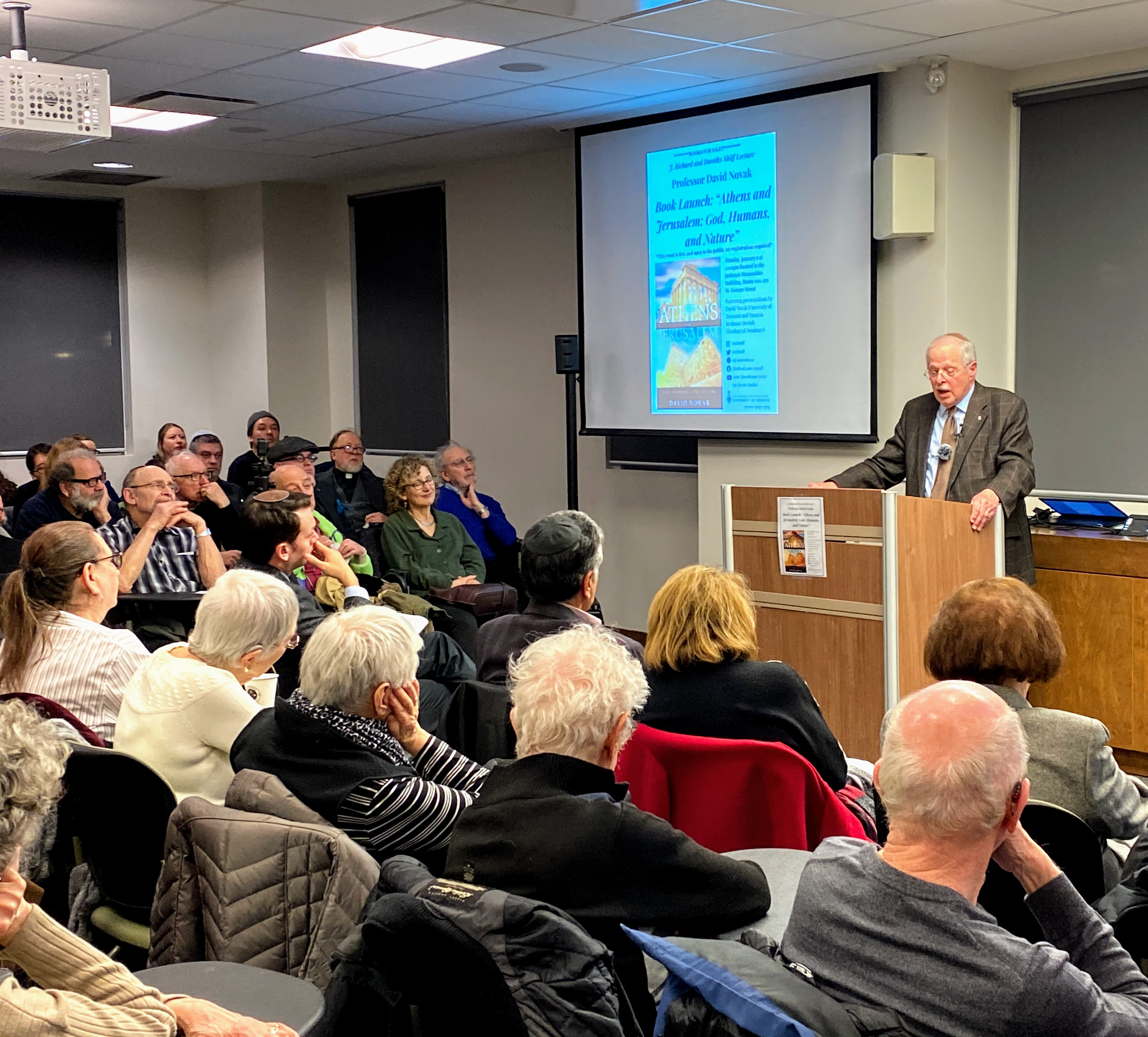 Photo of David Novak speaking at his book launch at the ATCJS