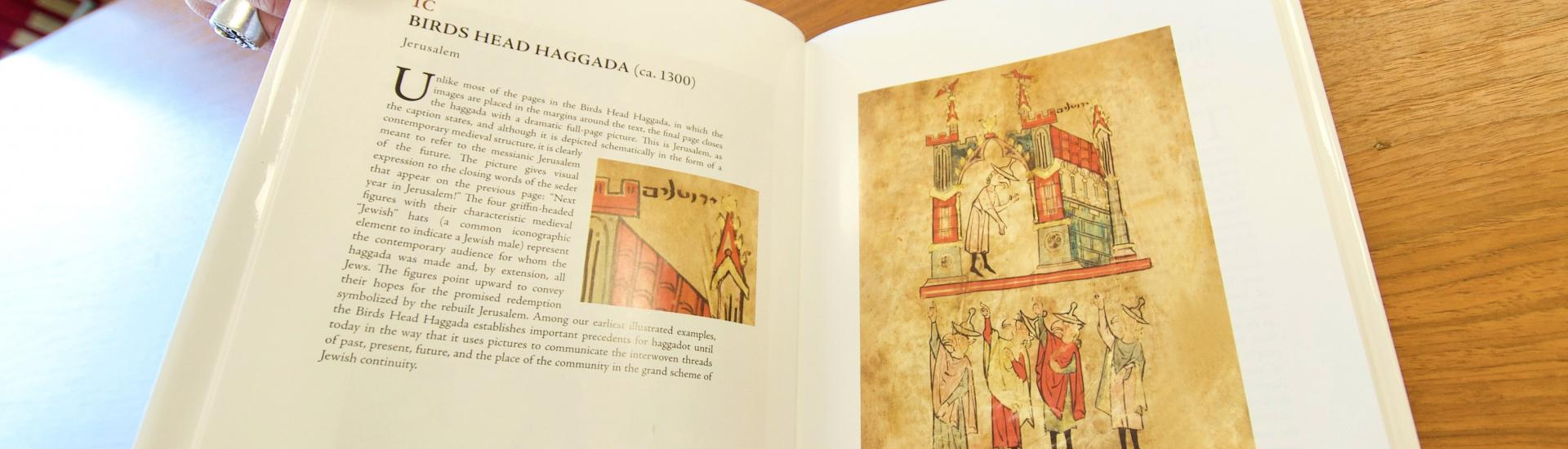 Adam Cohen shows a page from his new book on Jewish art history